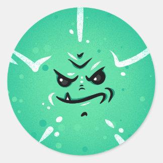 Sticker Rond Visage vert drôle de monstre avec le sourire de