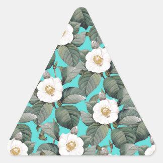 Sticker Triangulaire Camélia blanc sur le motif turquoise