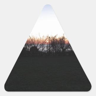 Sticker Triangulaire Coucher du soleil de mer avec la silhouette