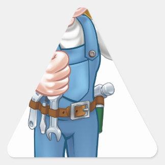 Sticker Triangulaire Électricien de femme de bande dessinée tenant le