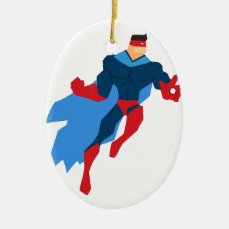 Super héros dans l'action ornement ovale en céramique