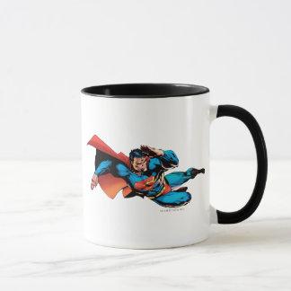 Superman pilotant le coup-de-pied mugs