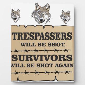 survivant de loup ouais plaque photo