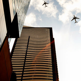 Airplanes flying over buildings