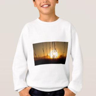 Sweatshirt Lever de soleil brumeux sur l'île de St Joseph