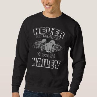 Sweatshirt Ne sous-estimez jamais la puissance d'un HAILEY
