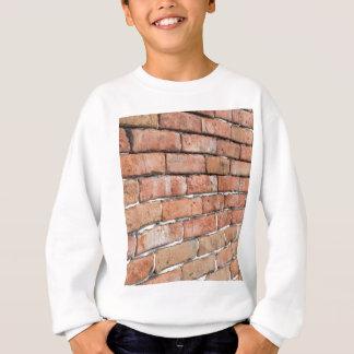 Sweatshirt Vue d'un vieux mur de briques avec une tache floue