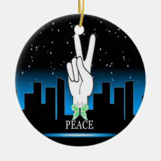 Symbole de paix avec un arrière - plan de ville ornement rond en céramique
