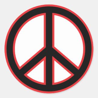 Symbole de paix rouge et noir autocollants ronds