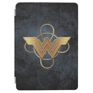 Symbole d'or de femme de merveille au-dessus de protection iPad air