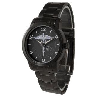 Symbole médical de caducée de monogramme sur le montres bracelet
