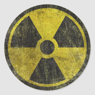 Symbole radioactif grunge sticker rond