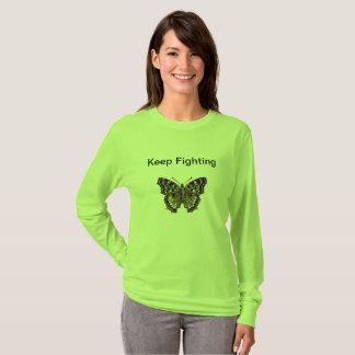 T-shirt Continuez à lutter la chemise de fibromyalgie pour