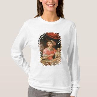 T-shirt Fille tenant une poupée dans un intérieur