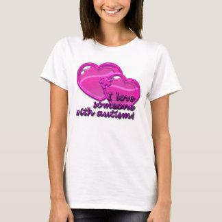 T-shirt J'aime quelqu'un avec la chemise d'autisme
