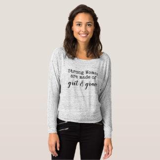 T-shirt la femme forte sont faites en poussière abrasive