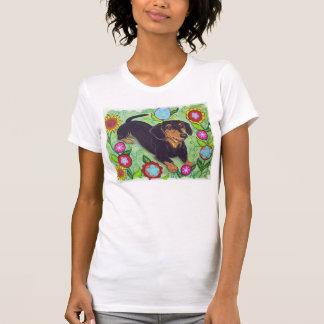 T-shirt Le teckel heureux dans le jardin fleurit le
