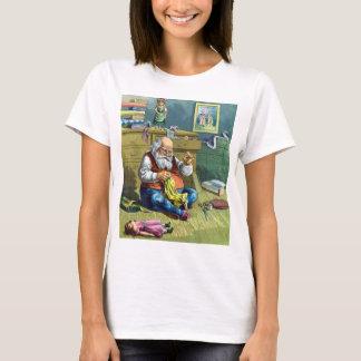T-shirt Noël vintage, le père noël faisant des poupées de
