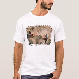 T-shirt Trois cowboys et cow-girls conduisant des bétail