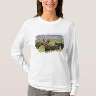 T-shirt Un propriétaire d'un ranch à cheval pendant un