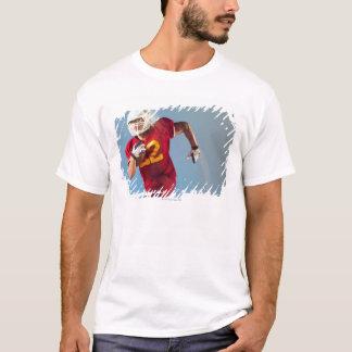 T-shirt Vue brouillée de joueur de football fonctionnant