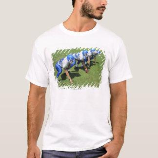 T-shirt vue courbe du jeu de quatre joueurs de football