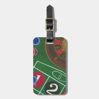 Tableau de roulette avec les puces et la roue étiquette pour bagages