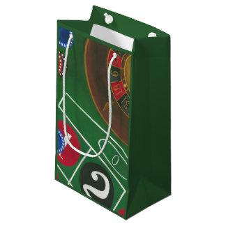 Tableau de roulette avec les puces et la roue petit sac cadeau