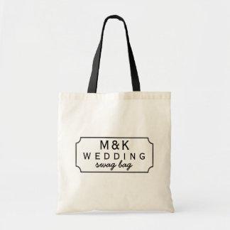 Tableau noir encadré épousant le sac de butin