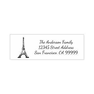 Tampon Auto-encreur Tour Eiffel - individu encrant le timbre d'adresse