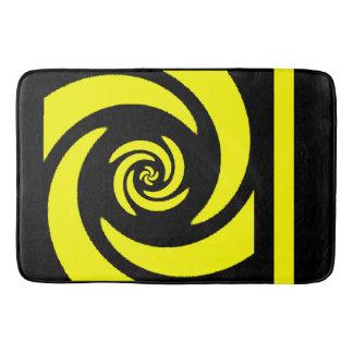 Tapis de bain en spirale noir et jaune de