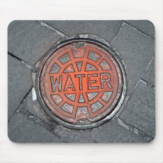 Tapis de souris de drain de l'eau