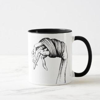 Tasse attachée de mains