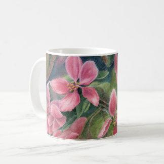 Tasse avec des fleurs d'Apple