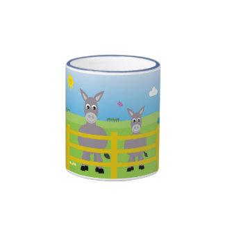 Tasse bleue de sonnerie d'ânes mignons de bande de