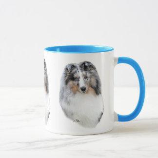 Tasse bleue de tête de merle de chien de berger de