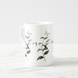 Tasse botanique de porcelaine tendre de fleurs