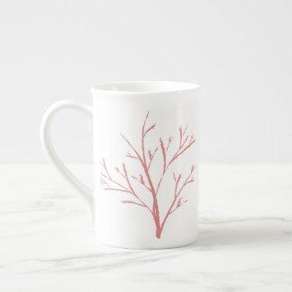 Tasse classique de porcelaine tendre de plante
