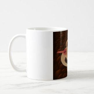 Tasse de café avec des morceaux de chocolat foncé