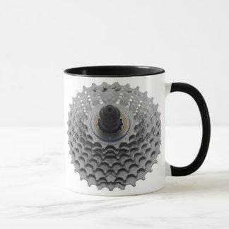 Tasse de café avec le pignon de vélo
