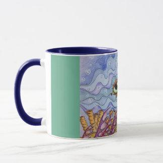 Tasse de café de yeux de poissons d'océan