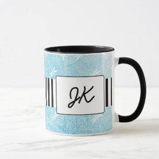 Tasse de café décorée d'un monogramme noire et