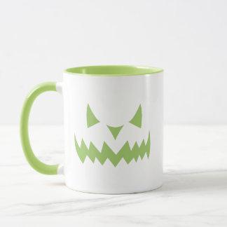 Tasse de café effrayante de citrouille de