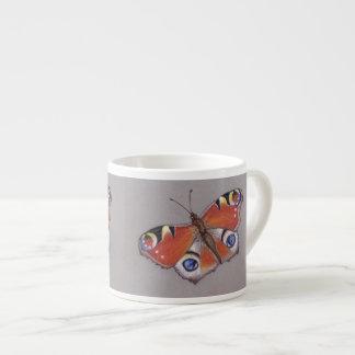 Tasse de café express de papillon de paon