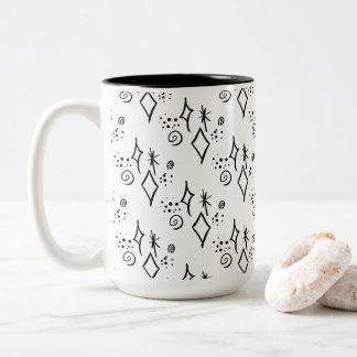 Tasse de café noire et blanche mignonne