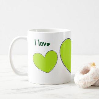 Tasse de café verte de coeurs d'amusement