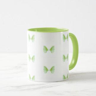 Tasse de café verte mignonne de motif d'abrégé sur
