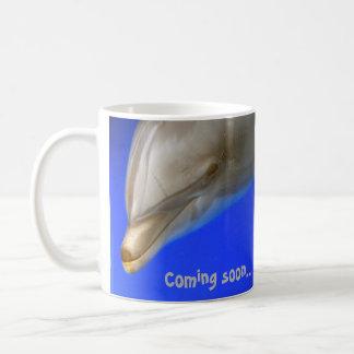 Tasse de dauphin (vacances) venant bientôt