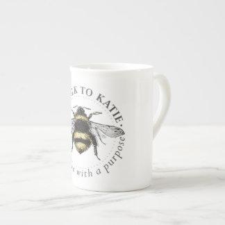 Tasse de logo d'abeille
