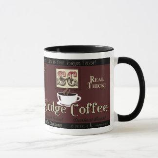 Tasse de marque de café de boue